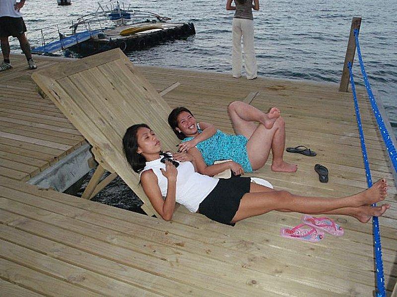 Sun loungers on the beach resort pier.